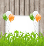 Greeting card with grass and balloons in Irish fla Stock Image