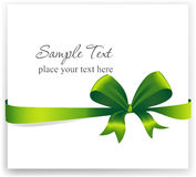 Greeting card with a green ribbon Stock Images