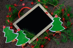 Greeting card handmade christmas decoration christmas trees from felt with red stars and black chalkboard Royalty Free Stock Image