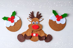 Greeting card handmade christmas rudolph reindeer from felt with christmas pudding Royalty Free Stock Photos