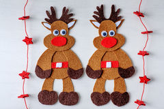 Greeting card handmade christmas rudolph reindeer from felt and red stars Stock Images