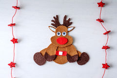 Greeting card handmade christmas rudolph reindeer from felt and red stars Royalty Free Stock Images