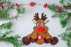 Greeting card handmade christmas rudolph reindeer from felt and red stars Royalty Free Stock Photos