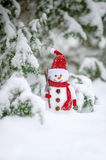 Greeting card with handmade snowman decoration in the forest winter time Royalty Free Stock Image