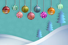 Greeting card of hanging christmast ball and pine on snow hill Royalty Free Stock Photography
