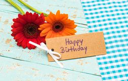 Greeting card Happy Birthday with colorful flowers. Happy birthday greeting card with fresh colorful flowers on blue wooden table stock images