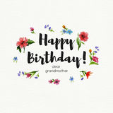 Greeting card Happy Birthday dear grandmother. Watercolor illustration with lettering and wreath of wildflowers Royalty Free Stock Images