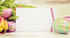 Greeting card happy easter. Happy easter greeting-card with eggs and tulips Royalty Free Stock Photo