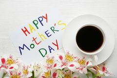 Greeting card Happy Mothers Day. Drawn by watercolor paints with flowers and cup of coffee stock images