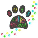 Greeting card Happy New Year. The imprint of dog paws and a handwritten inscription. Holiday Vector Illustration of the year yellow dog. Graphic design for Stock Photos