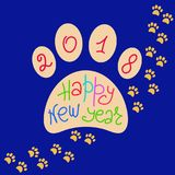 Greeting card Happy New Year. The imprint of dog paws and a handwritten inscription. Stock Photography