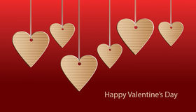 Greeting card Happy Valentines day. Greeting card for Valentines Day cardboard hearts on a red background Stock Image
