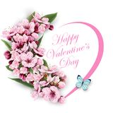 Greeting card happy Valentines day with a heart of flowers. Pink cherry blossoms with blue butterfly. Template for birthday cards, mothers day card spring Royalty Free Stock Photos