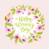 Greeting card Happy Women`s Day with flower wreath and lettering. Watercolor 8 March card. Greeting card Happy Women`s Day with spring flower wreath. Watercolor Vector Illustration