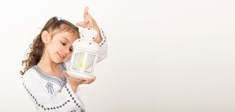 Greeting Card : Happy young Muslim girl playing with lantern in. Ramadan Stock Photography