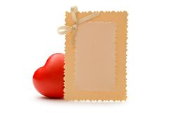 Greeting card and heart Stock Images