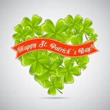 Greeting card with heart of clovers and ribbon? Royalty Free Stock Images