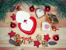 Greeting card heart composition on wooden background Royalty Free Stock Images