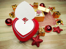 Greeting card heart composition on wooden background Royalty Free Stock Photos
