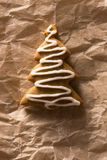 Greeting card with the image of a Christmas tree cookie Stock Images