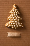 Greeting card with the image of a Christmas tree cookie Stock Photography