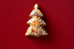 Greeting card with the image of a Christmas tree cookie Royalty Free Stock Images