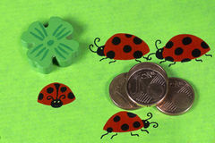 Greeting card with ladybirds and cent coins Stock Photos
