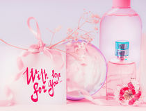 Greeting card laid with text lettering With love for you and pink cosmetic products setting.  Invitation, coupon, discount and sal. E.  Beauty, skin and hair Stock Images
