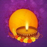 Greeting card with lit lamp for Happy Diwali celebration. Royalty Free Stock Photo