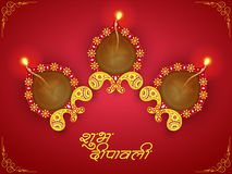 Greeting card with lit lamps for Happy Diwali celebration. Stock Images