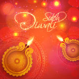 Greeting card with lit lamps for Happy Diwali. Stock Image
