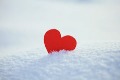 Greeting card with lonely heart on the dazzling blue snow royalty free stock photography