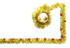 Greeting card made of yellow and green tinsel frame with red christmas balls Royalty Free Stock Images