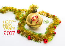 Greeting card made of yellow and green tinsel frame with red and golden christmas balls Stock Photo