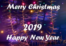 Greeting card for Merry Christmas and Happy New Year. On a blue background with New Year spectacular decorations stock photography
