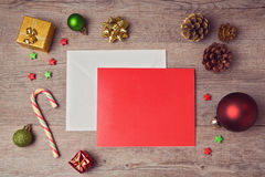 Greeting card mock up template with Christmas decorations on wooden background. View from above Stock Photos
