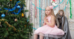 Greeting card with monkey, girl, new year tree, decorations Stock Images