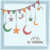 Greeting card with moons and stars for Eid Mubarak. Royalty Free Stock Image