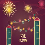 Greeting card with mosque for Eid festival celebration. Beautiful mosque design decorated with colorful lights on firecrackers decorated background for Islamic Stock Image
