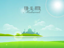 Greeting card with mosque for Eid festival celebration. Stock Photos