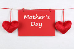Greeting card on Mothers day with copyspace and two hearts Royalty Free Stock Photos
