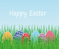 Greeting card with multi-colored Easter eggs in green grass. Free form for text or advertising. Vector. Invitation to the holiday Royalty Free Stock Image