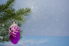 Greeting card for New year or Christmas. Postcard for the New year with a fir branch on a background of frosty Windows Royalty Free Stock Photography