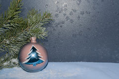 Greeting card for New year or Christmas. Postcard for the New year with a fir branch on a background of frosty Windows Royalty Free Stock Photos