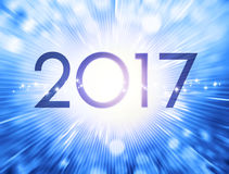 Greeting card 2017. New Year date 2017 on a festive blue background Royalty Free Stock Images