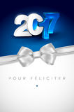 Greeting card for New Year 2017. Glowing 3D lettering 2017 on blue background and silver bow - greeting card for New Year 2017 with place for your text. PF 2017 Royalty Free Stock Image