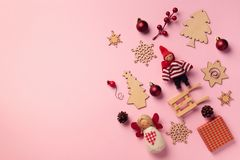 Greeting card for New year party. Christmas gifts, decorative elements and ornaments on pink background. Top view, copy space. Winter holiday concept royalty free stock photography