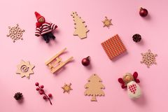 Greeting card for New year party. Christmas gifts, decorative elements and ornaments on pink background. Top view. Winter holiday. Concept royalty free stock image