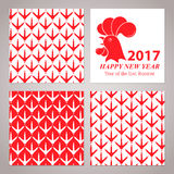 Greeting card for the New Year 2017. Red rooster on white background. Set of seamless patterns with chicken footprints Stock Image