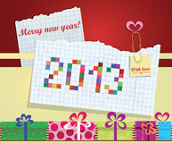 Greeting card of notebook sheet and lettering 2013. Collage of gift boxes Royalty Free Stock Photos